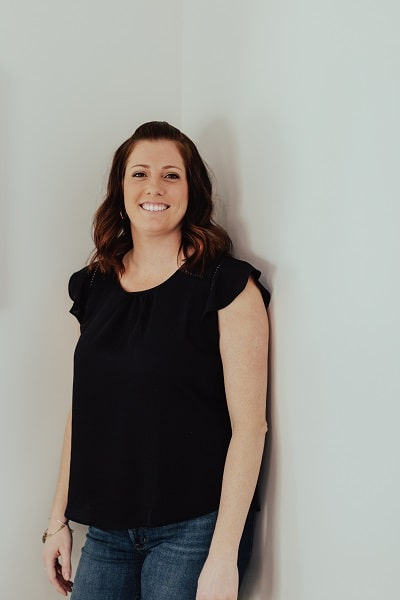Lindsay, one of our dental hygienists standing in front of a white background